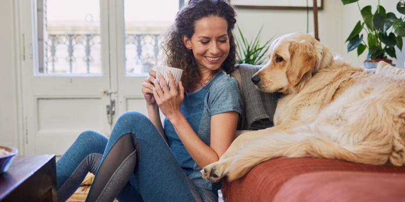 woman drinking coffee with dog